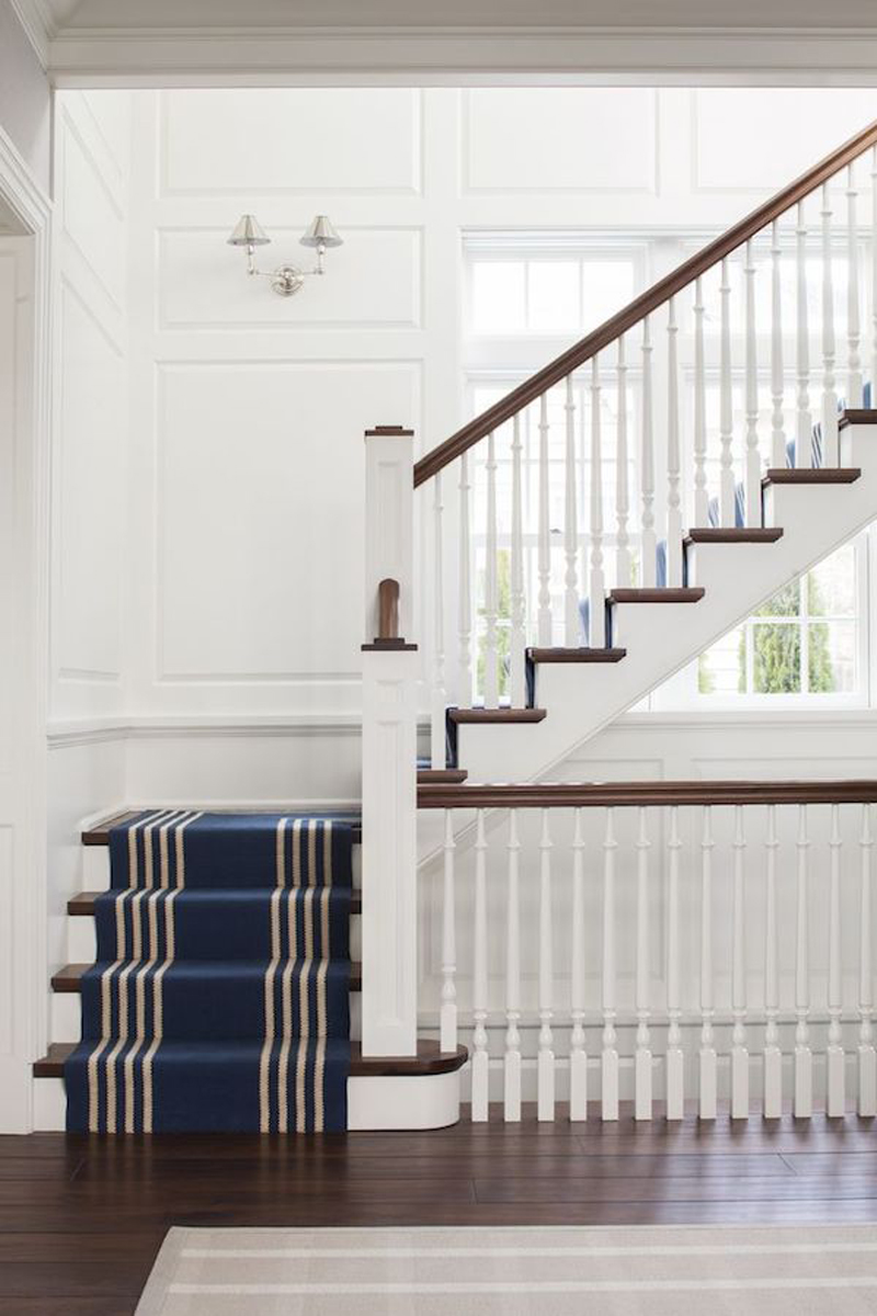 Wood-and-White-Staircase-with-Navy-Blue-Striped-Runner-SB-Long-Interiors