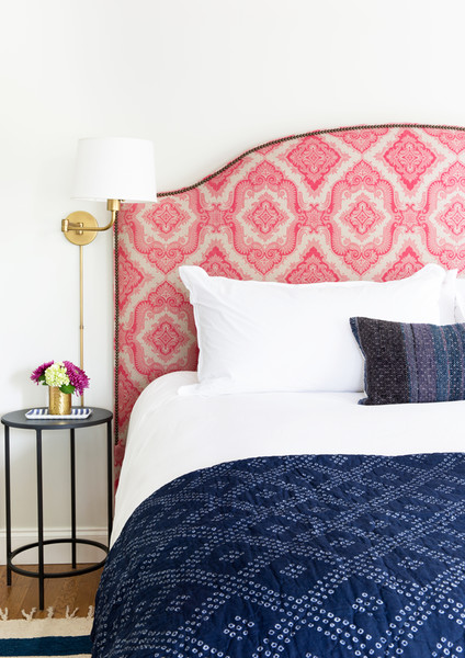 Pink-Graphic-Headboard-Gold-Sconce