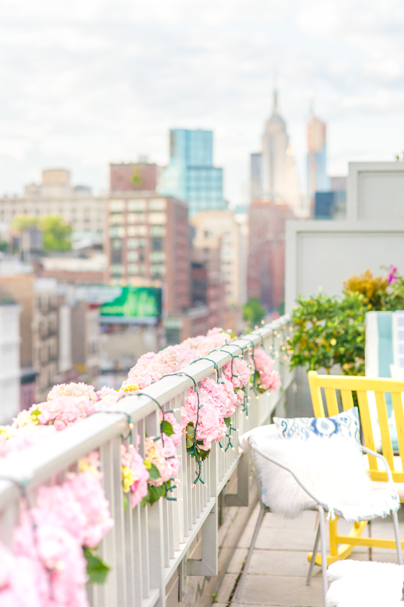 New York City Party Ideas Pink Hydrangeas White Twinkly Lights West Elm Pillow City Views